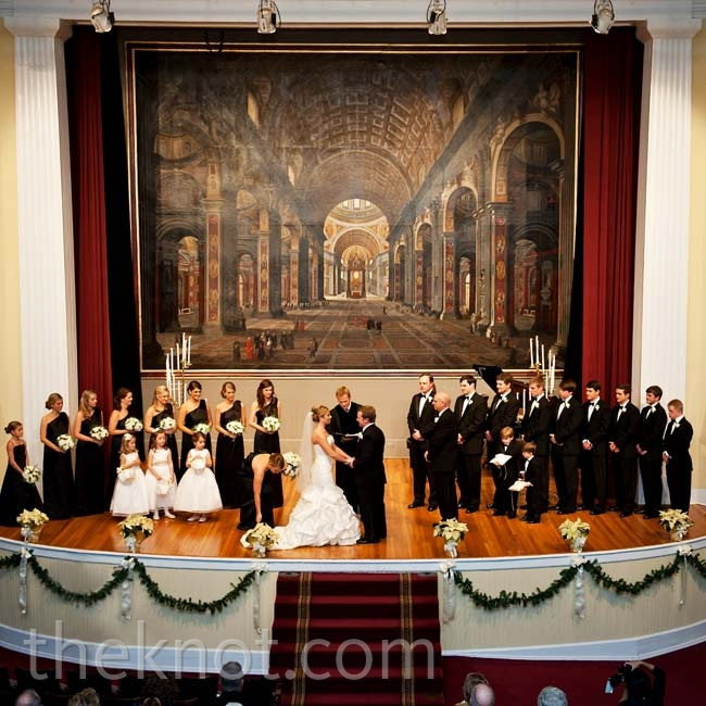 A large oil painting of St. Peter's Church in Rome was the backdrop to the couple's church ceremony.