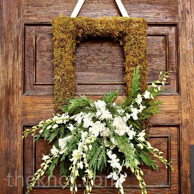 A moss frame gave a rustic feel to the ceremony entrance.