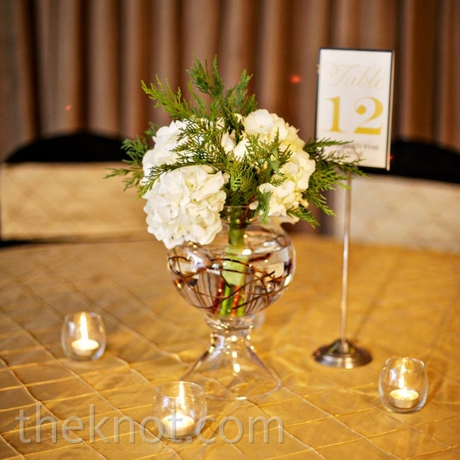 The couple had varying table arrangements, one of which was made up of low centerpieces and dimly lit tea lights.