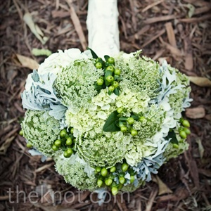 Julia carried an earthy, green arrangement with powder-blue and ivory accents.