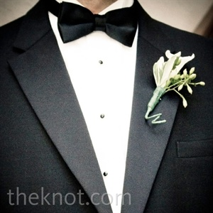 Patrick's boutonniere was white with hints of fresh greenery.
