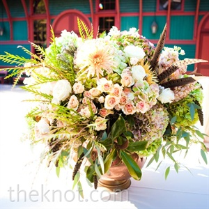 The largest centerpiece consisted of the same flowers and cotton bolls found in Rachel's bouquet.
