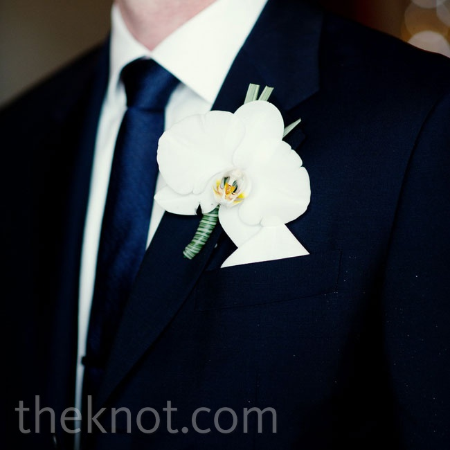 Matt wore a navy-blue suit and a white orchid boutonniere that matched Renee's cascading orchid bouquet.