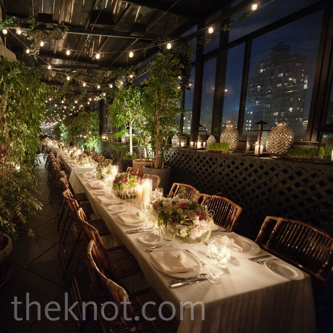 Classic white linens gave the long banquet tables a clean look, while candles and string lighting set an intimate mood. Vines and foliage covering the walls and surrounding the tables created an overgrown garden feel.