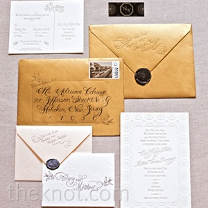 Their customized invitation suite was inspired by the venue, with antique gold envelopes, Beaux Arts detailing and a stamp depicting the Capitale site back when it was a bank.