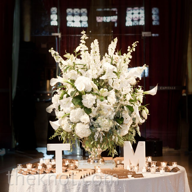 A dramatic arrangement of Casablanca lilies surrounded by tented cards and the couple's initials wowed guests when they walked into the room.