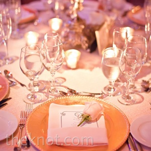 Gold beaded chargers dressed up the ivory linens, while a single rose placed on each menu added a touch of romance.