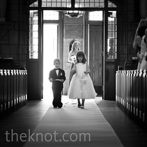 Matt's daughter walked down the aisle in a white dress, while the ring bearer, Matt's nephew, wore a tiny tux.