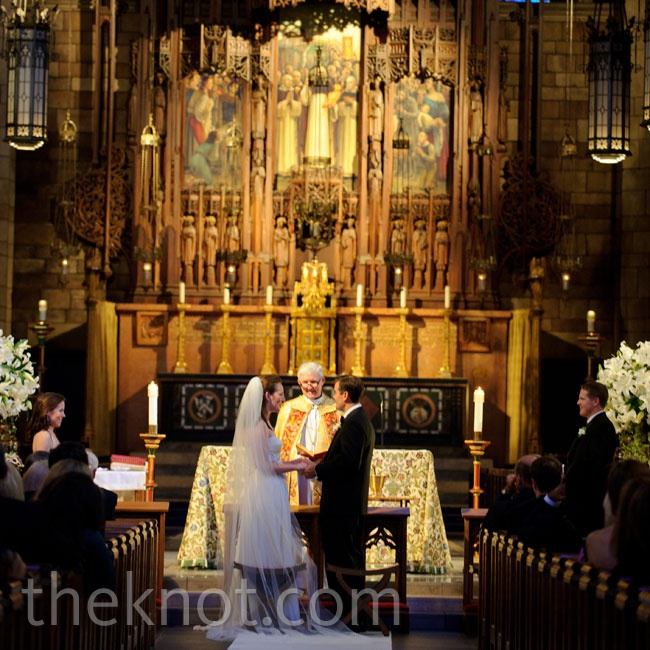 The couple exchanged vows in a Gothic-style Catholic church. The dramatic space called for little decoration, so they just added two lily arrangements at the altar.