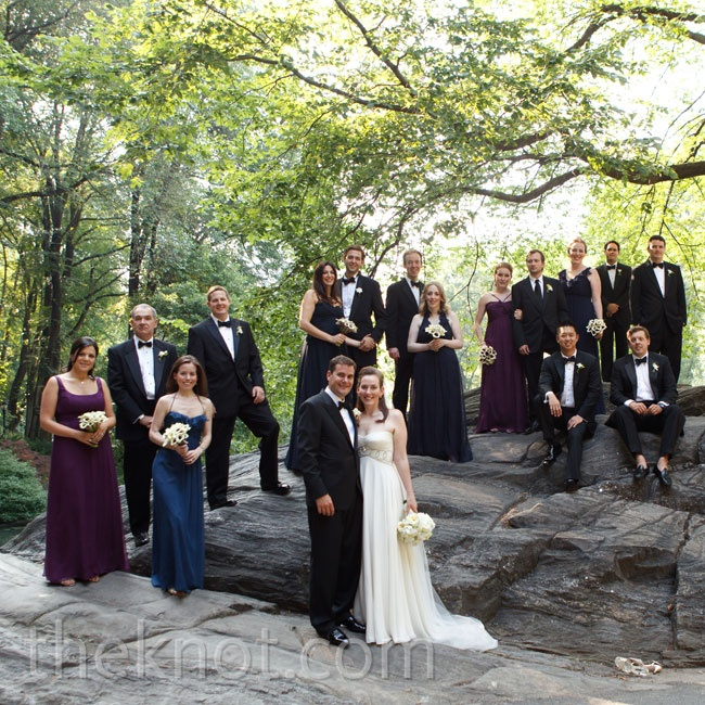 The bridesmaids wore floor-length gowns in deep purple and dark blue, and the groomsmen wore tuxes.