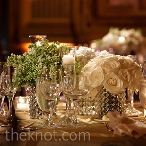 Low, crystal vases showcased bunches of white roses and sweet peas to match Nora's bouquet.