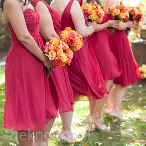 Each bridesmaid chose her own dress style. The only requirement: the cranberry hue. Textured bouquets in tangerine and rust popped in contrast.