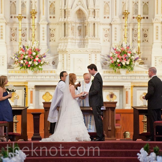 Not wanting to overwhelm the church's beautiful decor, the couple added only two arrangements at the altar.