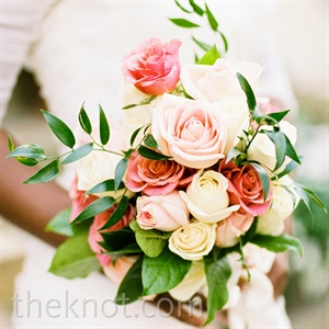 Salal leaves and Italian ruscus added a wild, garden-like appeal to Nkechi's arrangement of ivory and pink roses.
