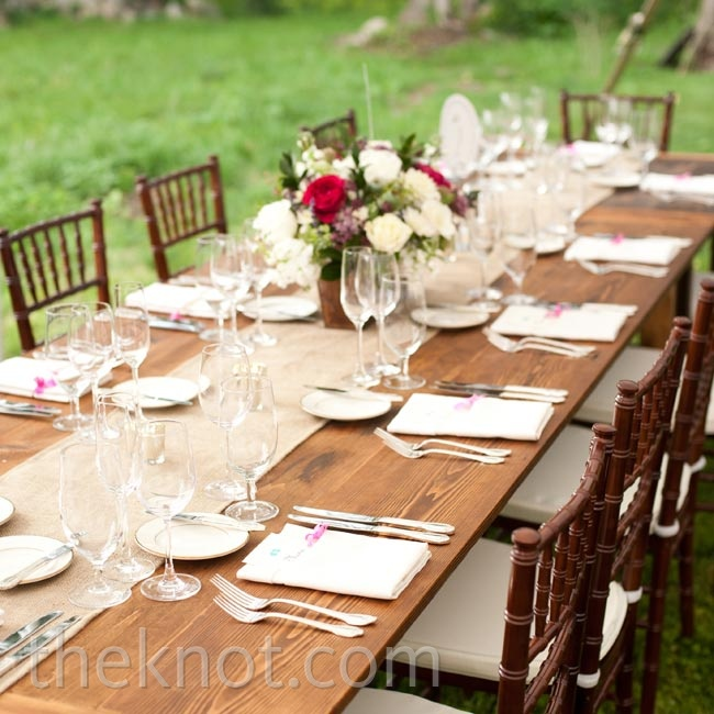 Simple, long farm tables and burlap runners created a chic, rustic vibe at the reception.