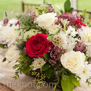 Vibrant red garden roses, white dahlias and greens created a wildflower-like look for the centerpieces.