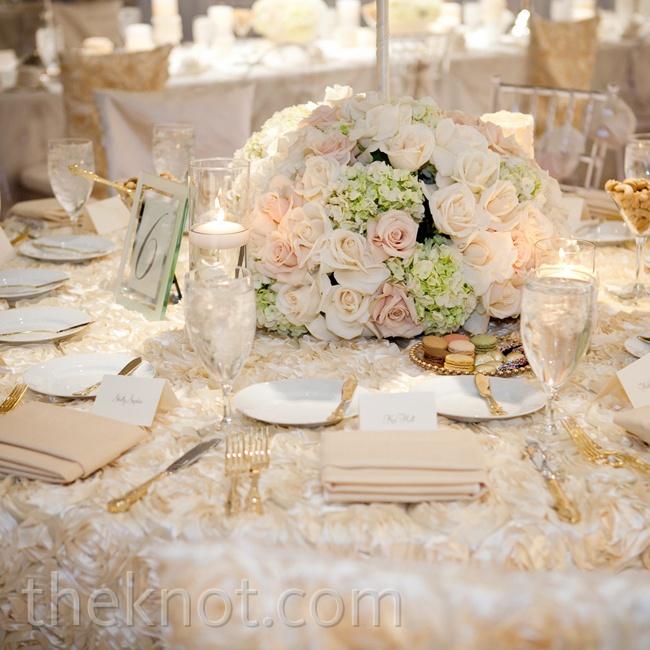 Ghost and clear chiavari chairs blended seamlessly with the all-white centerpieces, table linens and chair backs.