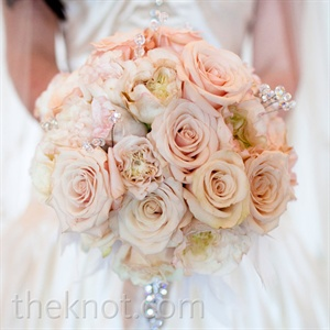 Justine carried a lush arrangement of cream roses with crystal accents.