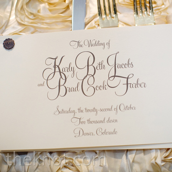 An embellished brad held together the scripted card stock for a