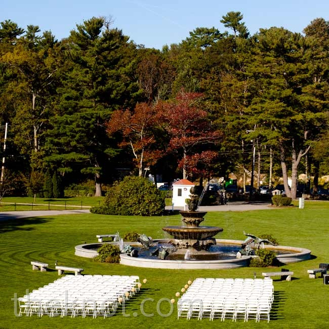 The couple wed on the manor's front lawn, with the fountain as a backdrop.