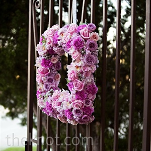 Vibrant-pink floral wreaths adorned the courtyard's iron gates.