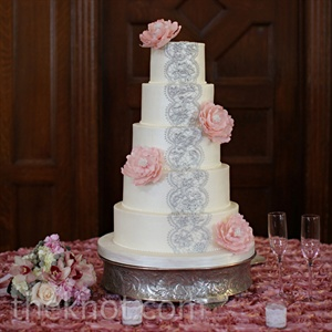 Sugar peonies and gray-lace detailing lined the round cake.