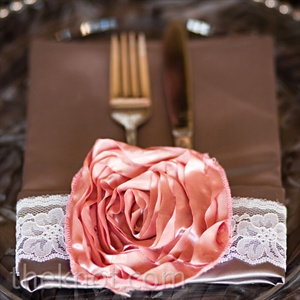 The pink-satin rosettes and white-lace napkin bands were Sharon's favorite elements of the table.
