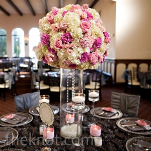 Tall vases with white hydrangeas, pink roses and dripping crystals popped against the charcoal table linens.