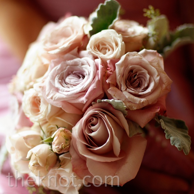 A lush yet muted arrangement of ivory and pink roses let the jeweled neckline of Patricia's dress be the focus.