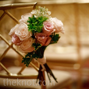 Small rose bunches lined the ceremony aisle.