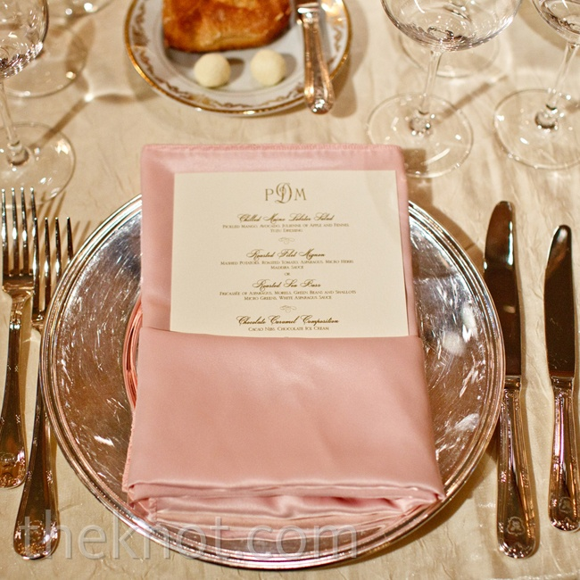 Pink napkins displayed the elegant scripted menu cards.