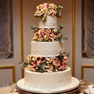 Sugar roses that mimicked Patricia's bouquet separated the three tiers of the traditional cake for a floating effect.