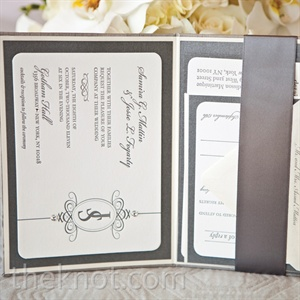 The wedding's sparkling theme was foreshadowed through steel-gray, crystal-encrusted invites.