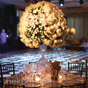 One of the four tablescape variations included large, Fabergé cut-crystal vases overflowing with white roses, calla lilies, orchids and hydrangeas.