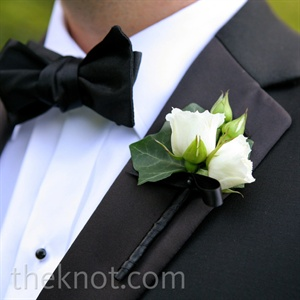 Petite white blooms complemented the groom's formal black tux.