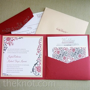 A delicate scroll-and-floral design decorated the bold invitations.