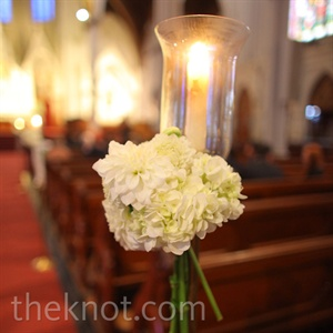 Candles and hydrangeas decorated the ceremony pews.