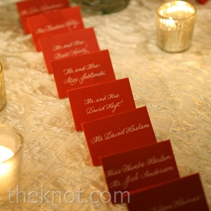 Small red envelopes held guests' table assignments.