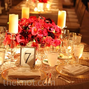 Deep-red roses, calla lilies, and dahlias, filled vases on the reception tables.