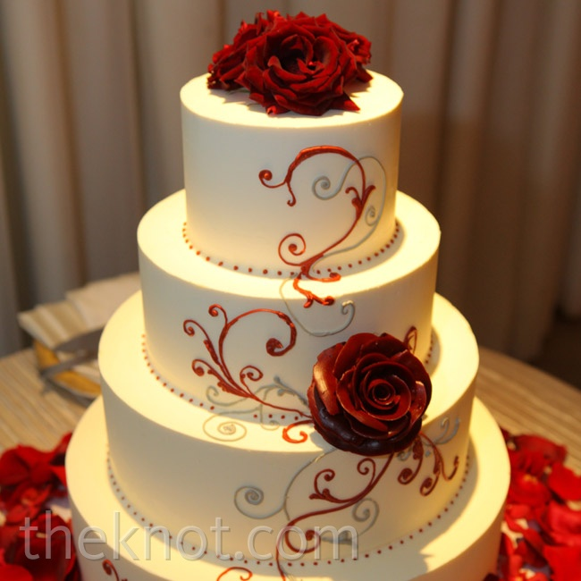 The couple's cake baker incorporated the red-and-silver scroll design from their invitations.