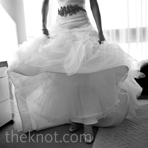 Samira accessorized her Vera Wang organza and tulle mermaid-style gown with a crystal-and-ribbon sash, glittering Christian Louboutin heels, oversize crystal earrings and two different veils, both handmade by her mother.