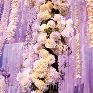 Trees dripping with floral garlands provided a breathtaking background for the couple's nuptials.