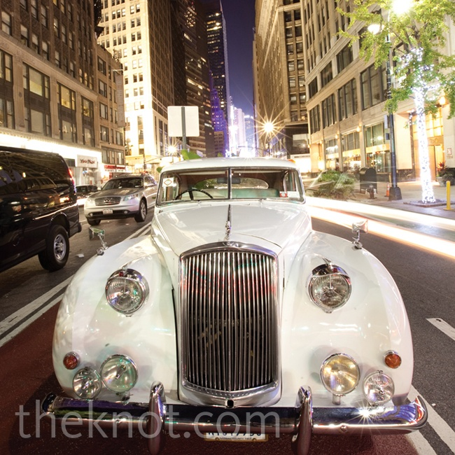 An antique white Rolls-Royce whisked the couple away at the end of the night.