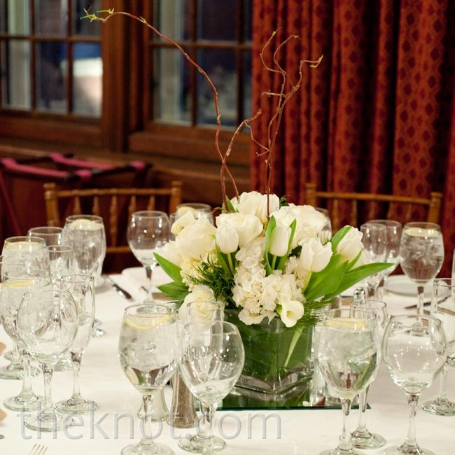 Tables were topped with arrangements of rose, tulips, and calla lilies (alternating in color between white and red across the room).