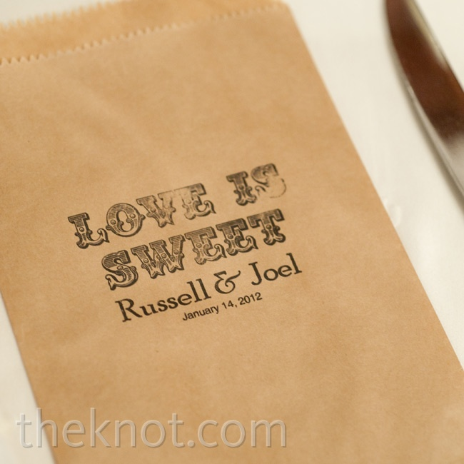 "Each guest found a stamped favor bag with the slogan ""Love is Sweet"" at their seat. Everyone filled their bags with candies from the dessert bar."