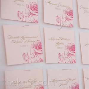 All of the wedding paper was decorated with a pink rose motif and gold writing.