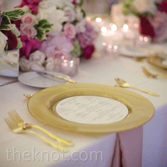 The dinner tables were elegantly arranged with lush pink flowers, votive candles, gold flatware and a round menu card cut to fit the center of the gilded chargers.
