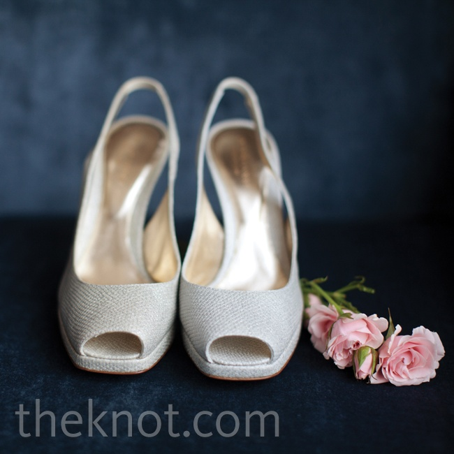 The silver leather of Tiffany's Sergio Rossi peep-toe pumps complemented the wedding's overall palette.