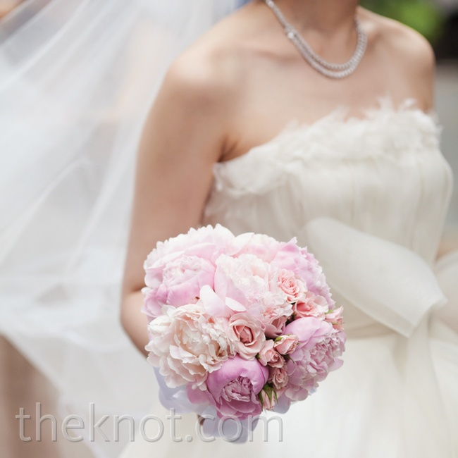 Lush peonies fell in line with the romantic, garden-inspired look of the day.