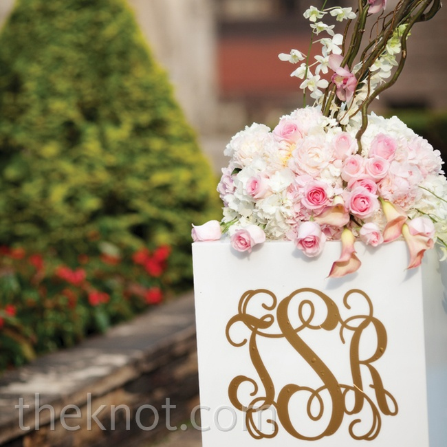 A custom vinyl monogram added a personal touch to the two ceremony-arch pedestals.